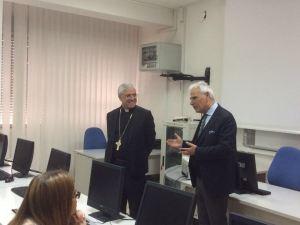 Mons. Luigi Renna durante la visita all'Olivetti